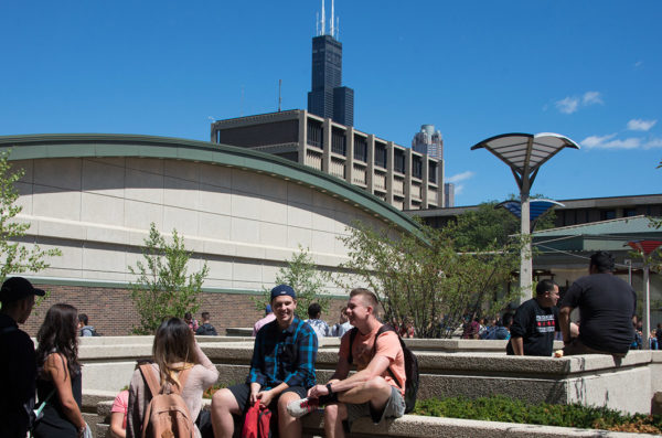 Campus shot with students sitting together