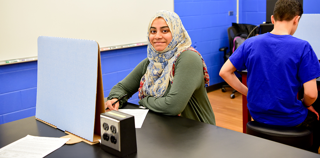 Muslim student smiling in science lab