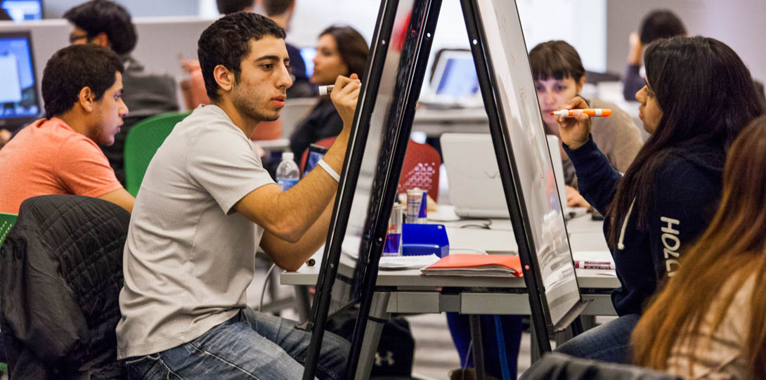 students participating in classroom activities