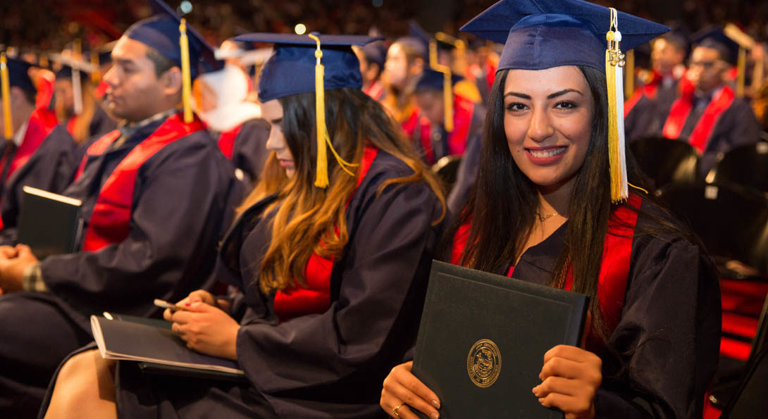 A student holding her diploma