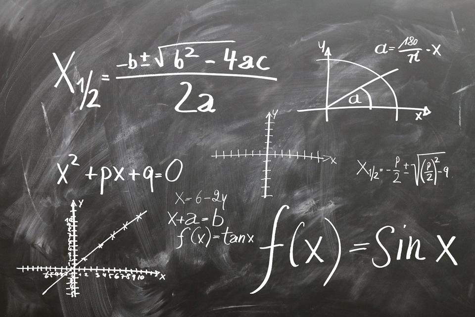 physics formula on chalkboard