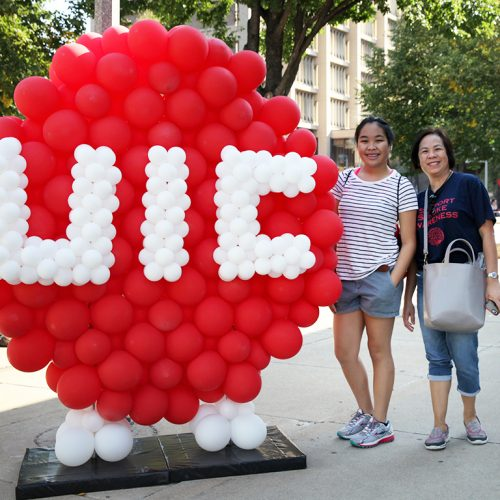 UIC logo in balloons with two females