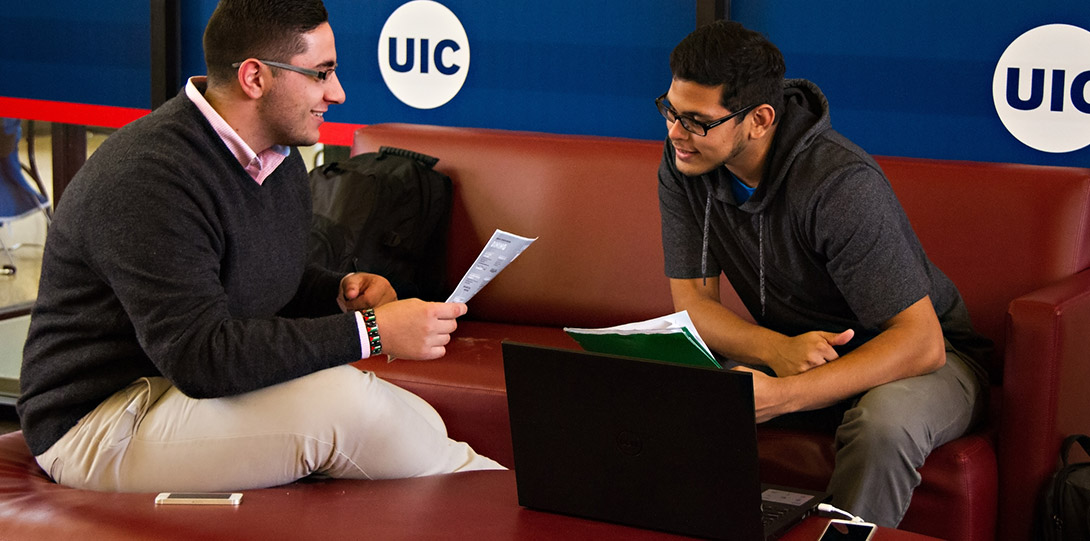 Latino male students in study area on campus